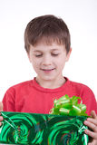 The boy has received a gift. Holds a box with a gift Stock Images