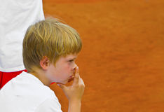 Boy has a rest at the tennis court Stock Image