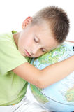 Boy has tired and sleeps. On globe Royalty Free Stock Photos