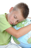 Boy has tired and sleeps on globe. Over white background Royalty Free Stock Images