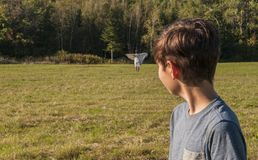 Boy has vision or apparition of his mother dead, or lost in far distance Stock Photo