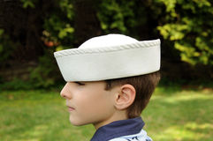 Boy in Hat. Portrait of a young boy in sailor hat Stock Image