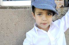 Boy with hat. A young boy in the street with a hat Royalty Free Stock Photos