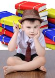 A boy on the background of books Royalty Free Stock Image
