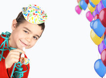 Boy with hat and balloons. Happy boy with party hat and balloons Stock Images