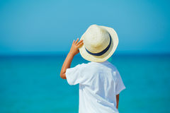 Boy with hat on the beach Stock Photos