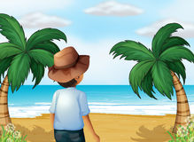 A boy with a hat at the beach Stock Photos