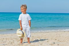 Boy with hat on the beach Stock Image