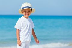 Boy with hat on the beach Stock Photo