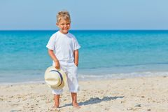 Boy with hat on the beach Stock Images