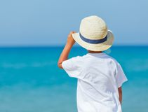 Boy with hat on the beach Royalty Free Stock Image