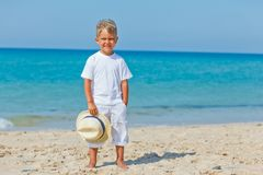 Boy with hat on the beach Stock Photography