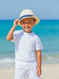 Boy with hat on the beach Royalty Free Stock Photos