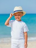 Boy with hat on the beach Royalty Free Stock Photography