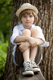 Boy in the hat on the bench Royalty Free Stock Photos