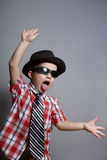 The boy in a hat and black glasses Royalty Free Stock Image