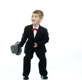 Boy in hat and black suit Royalty Free Stock Photography