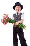 Boy in hat with a bouquet of carnations Stock Photos