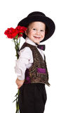 Boy in hat with a bouquet of carnations. Smiling boy in hat hiding behind a bouquet of carnations, isolated on white Stock Photos