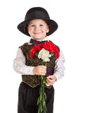 Boy in hat with a bouquet of carnations Stock Photography
