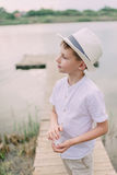 Boy in hat near the river Royalty Free Stock Images
