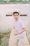 Boy in hat near the river Stock Image