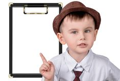 Boy in hat points to notes royalty free stock images