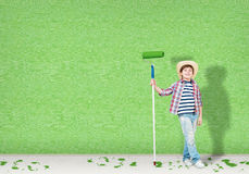 Boy in a hat with a roller for painting Stock Photography