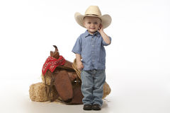 Boy with hat and Saddle Stock Images