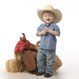 Boy with hat and Saddle Royalty Free Stock Photo