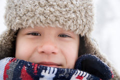Boy in hat and scarf Stock Photography
