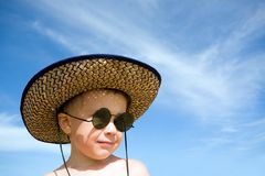 Boy.hat.sunglasses Royalty Free Stock Photography