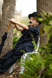 Boy with hat and umbrella. Young boy with a costume mustache, bowler hat and an umbrella Stock Photography