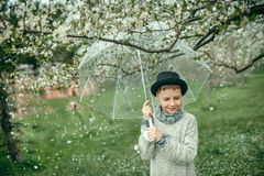 Boy in a hat with an umbrella Royalty Free Stock Photography