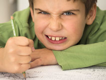 Boy hates doing homework Stock Photography