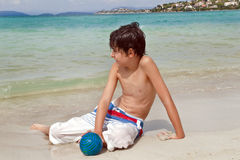 The  Boy is have fun at the Beach Stock Image