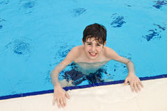 The Boy  is Have Fun in the Swimming Pool Royalty Free Stock Image