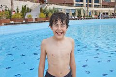 The Boy  is Have Fun in the Swimming Pool Royalty Free Stock Photography