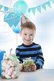 Boy having birthday party in blue decor Royalty Free Stock Photography
