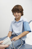 Boy Having Blood Pressure Taken Stock Images