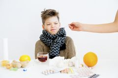 Boy having flu. A portrait of a sick boy having flu royalty free stock images