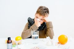 Boy having flu. A portrait of a sick boy having flu stock photography