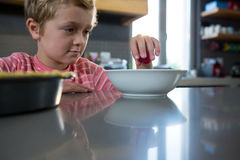 Boy having food in kitchen Royalty Free Stock Photos