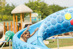 Boy having fun in aqua park. Young child having fun in aqua park Royalty Free Stock Photography