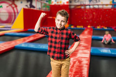 Boy having fun on attraction, entertainment center Royalty Free Stock Photography