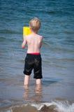 Boy having fun at the beach Royalty Free Stock Image