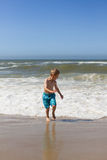 Boy having fun at beach Stock Images