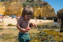 Boy having fun on the beach Stock Photography