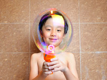 Boy having fun with bubbles Royalty Free Stock Images