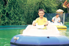 Boy having fun with bumper boats Stock Photo